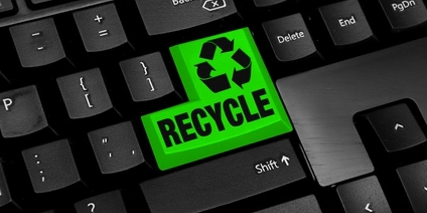 Image of computer equipment and keyboard with Recycling return key