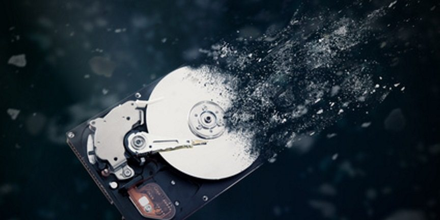 image of a hard drive being made safe using destruction and shredding methods for safe and secure data destruction